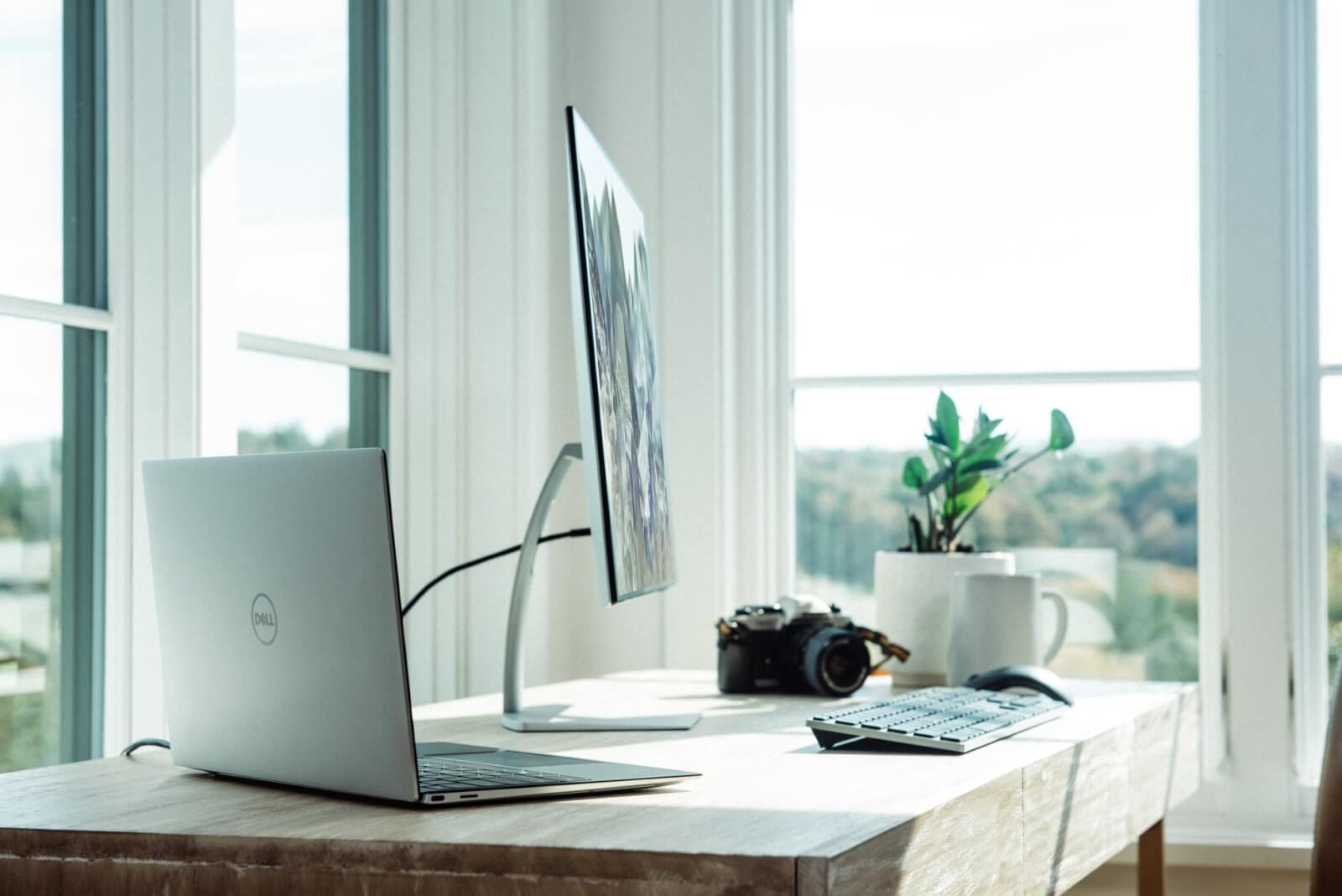 Desk with design laptop and desktop